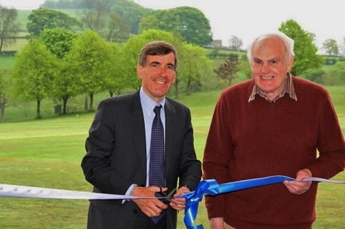 David Rutley M.P. cuts the tape with Chaiman Michael Hart