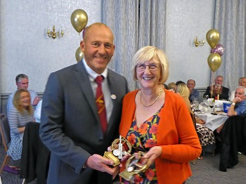 Mrs. Janice Bridgford accepts on behalf of her son James the 1st XI Bowling (Shared with M-B-J) and Player of the Season.