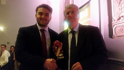 Mathew Fletcher takes Player of the year award from President Robert Street.